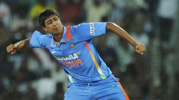 Rahul Sharma celebrates the wicket of Sunil Narine