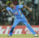 Rahul Sharma celebrates the wicket of Sunil Narine