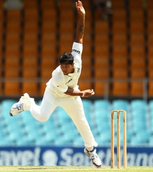 Umesh Yadav bowls on the opening day of India's tour, Cricket Australia Chairman's XI v Indians, Canberra, 1st day, December 15, 2011