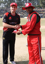 Jamie Atkinson shakes hands with Oman skipper Hemal Mehta during the coin toss for the ACC Twenty20 Cup 2011 semi-final played in Kathmandu on 9th December 2011