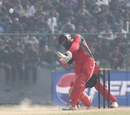 Oman's Ghazanfar Iqbal strikes an early boundary in the ACC Twenty20 Cup 2011 semi-final against Hong Kong at Tribhuvan University, Kathmandu on 9th December 2011