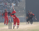 Oman's Vaibhav Wategaonkar hits Roy Lamsam down the ground for a single during the ACC Twenty20 Cup 2011 semi-final in Kathmandu on 9th December 2011