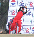 Oman's Zeeshan Siddiqui takes a great catch to dismiss Irfan Ahmed during the ACC Twenty20 Cup 2011 semi-final at Kathmandu on 9th December 2011