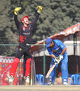 Mark Ferguson celebrates as Afghanistan's Asghar Stanikzai is bowled by Nadeem Ahmed in the ACC Twenty20 Cup 2011 final in Kathmandu on 11th December 2011