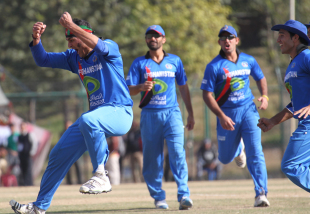 Hamid Hassan and the rest of the Afghanistan players celebrate the wicket of Irfan Ahmed during the ACC Twenty20 Cup 2011 in Kathmandu on 11th December 2011