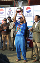 Afghanistan's skipper Nawroz Mangal lifts the ACC Twenty20 Cup 2011 Winners' Trophy after his team beat Hong Kong by 8 runs in the final played in kathmandu on 11th December 2011
