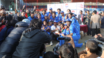 The victorious Afghanistan team is mobbed by the press