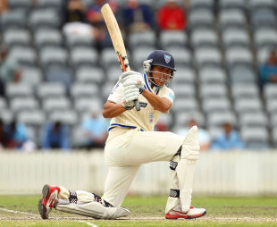 Usman Khawaja sweeps on his way to a half-century, Cricket Australia Chairman's XI v Indians, Canberra, 3rd day, December 21, 2011