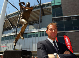 Shane Warne poses with a statue of himself unveiled at Melbourne Cricket Ground, December 22, 2011
