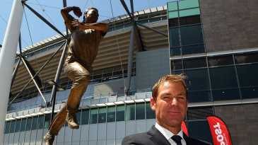 Shane Warne poses with a statue of himself unveiled at Melbourne Cricket Ground