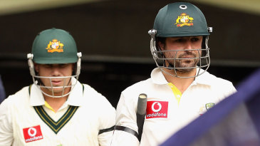 David Warner and Ed Cowan walk out to bat