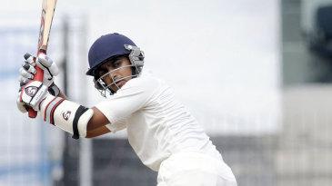 Harshad Khadiwale glances through fine leg during his 61