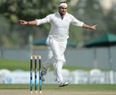 Hamid Hassan celebrates the dismissal of Andrew Strauss, ICC Combined XI v England XI, Dubai, 2nd day, January 8, 2012