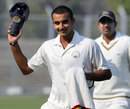 Harshal Patel raises his cap after his eight-wicket haul, Haryana v Rajasthan, 1st semi-final, Ranji Trophy 2011-12, Rohtak, 1st day, January 10, 2012