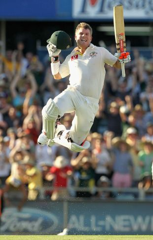 David Warner takes off after reaching his century with a six off his 69th ball, Australia v India, 3rd Test, Perth, 1st day, January 13, 2012