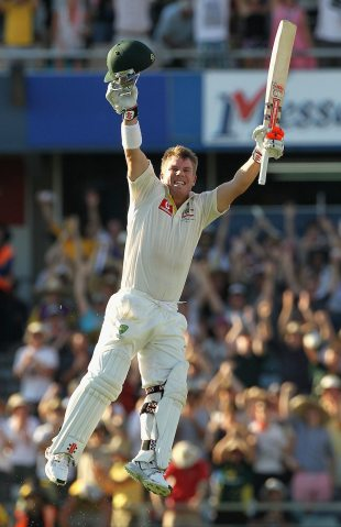 David Warner leaps in celebration after scoring the fourth quickest century in Test cricket