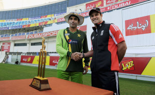 Pakistan captain Misbah-ul-Haq shakes hands with his England counterpart Andrew Strauss over the series trophy, Dubai, January 16, 2012