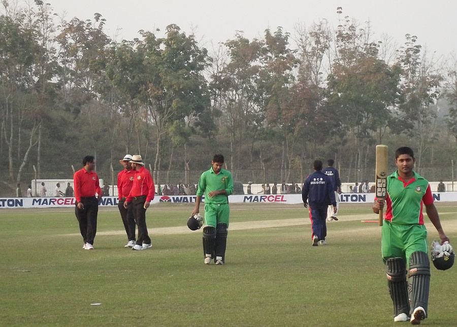 Imrul Kayes walks off having scored an unbeaten 110