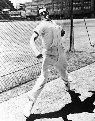 Alan Davidson bowls in the nets at Lord's ahead of his second Test, 1953