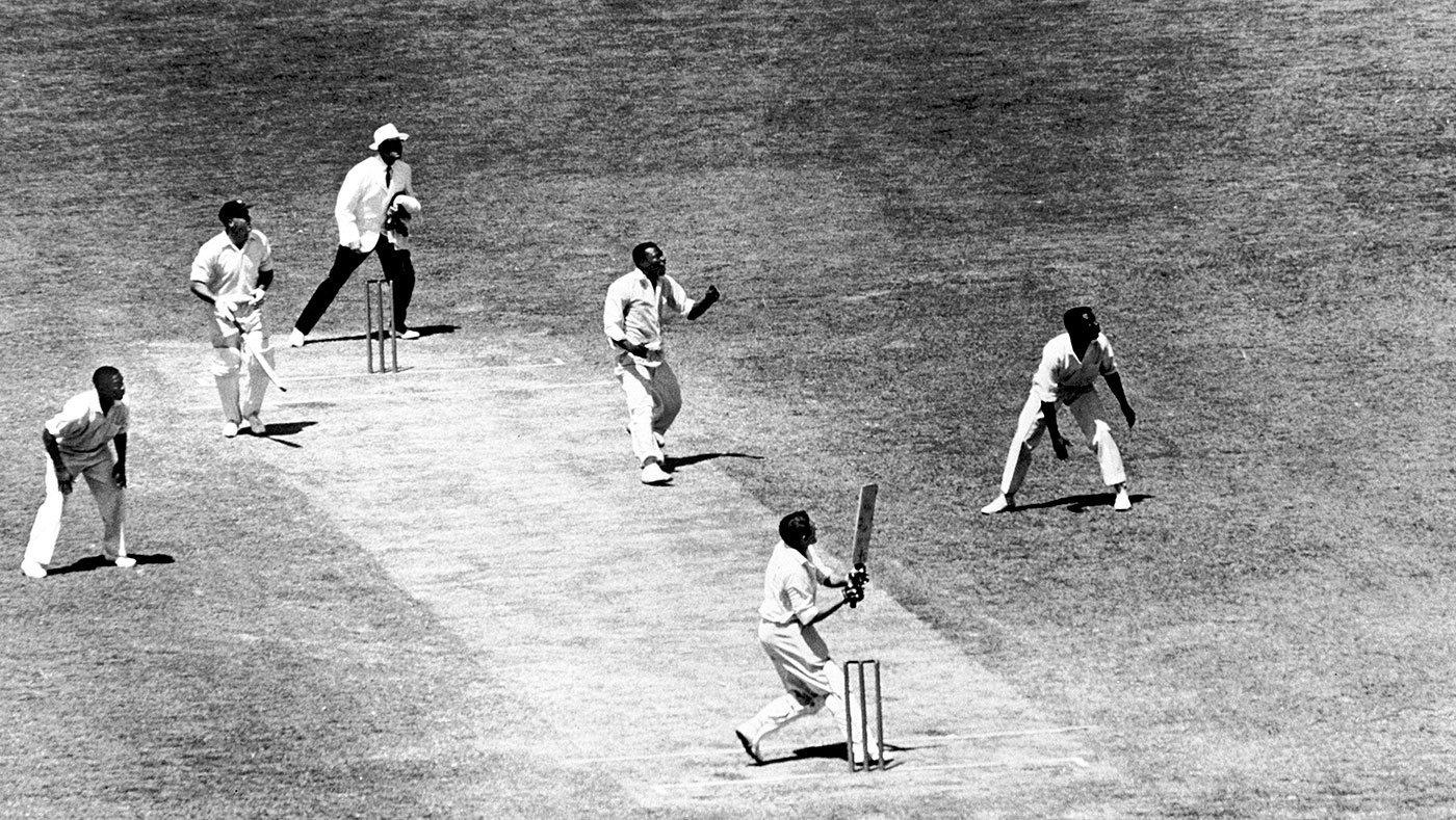 Alan Davidson hooks Wes Hall during the famous 1960-61 series in Australia