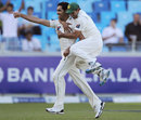 Umar Gul and Abdur Rehman celebrate Jonathan Trott's dismissal, Pakistan v England, 1st Test, Dubai, 3rd day, January 19, 2012