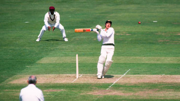 Graeme Wood is hit by a bouncer from Malcolm Marshall