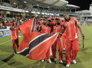 Trinidad & Tobago's players wave their flag after their win, Jamaica v Trinidad & Tobago, final, Caribbean T20 2011-12, Bridgetown, January 22, 2012