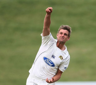 Sam Wells warms up ahead of a Plunket Shield match