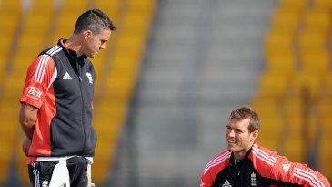 Kevin Pietersen looks concerned as Chris Tremlett feels his sore back