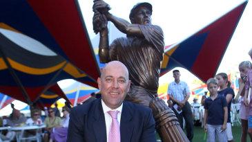 Darren Lehmann sits in front of a statue of himself