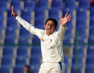 Saeed Ajmal celebrates dismissing Alastair Cook, Pakistan v England, 2nd Test, Abu Dhabi, 2nd day, January 26, 2012