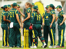 Ellyse Perry and her team-mates celebrate a wicket
