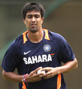 Rahul Sharma gets ready to bowl
