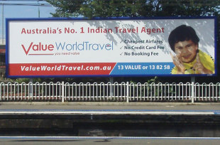 An advertising signboard at a train station
