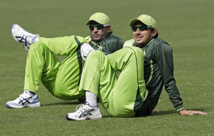 Abdur Rehman and Saeed Ajmal do a bit of stretching, Dubai, February 2, 2012