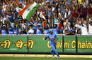 Indian fans cheer as Gautam Gambhir completes a catch to dismiss David Warner