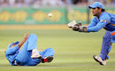 Virender Sehwag parries the ball to MS Dhoni, to have Shaun Marsh caught