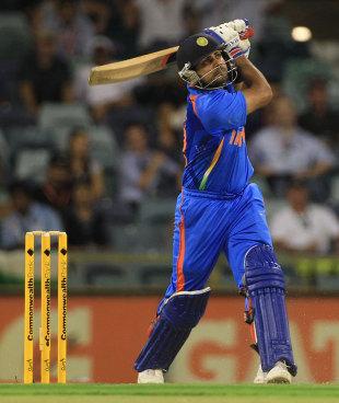 Virat Kohli pounds a six down the ground, India v Sri Lanka, CB Series, 2nd ODI, Perth, February 8, 2012