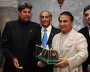 Sunil Gavaskar gets his ICC Hall of Fame cap from Kapil Dev