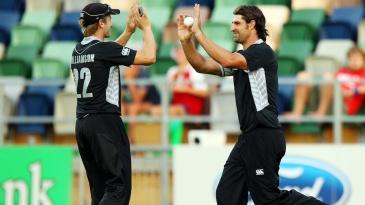 Colin de Grandhomme and Kane Williamson celebrate a wicket