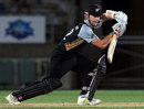 Kane Williamson drives through the off side