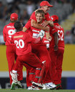 Zimbabwe mob Kyle Jarvis after getting a wicket