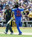 Dhoni carries India home in tight chase