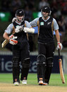 Kane Williamson and Andrew Ellis walk off after a successful chase