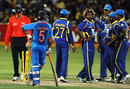 Gautam Gambhir and Sri Lanka await the third umpire's ruling on a run out