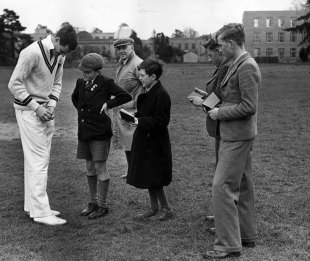 Ryneveld signs autographs for youngsters during a tour game against Oxford on the 1951 tour