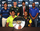 Captains pose with the ICC World Cricket League Division 5 trophy, Singapore, February 17, 2012