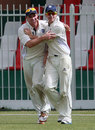 Ryan Flannigan celebrates with a team-mate after taking a catch