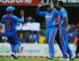 Virender Sehwag is congratulated on taking a diving catch to dismiss Mahela Jayawardene