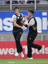 Tim Southee congratulates Rob Nicol after he completes a catch to dismiss Richard Levi